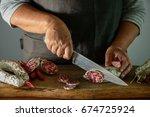 artisan salami is being cut...   Shutterstock . vector #674725924