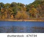 Boat across the lake - stock photo