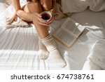 beautiful legs close up in bed. ... | Shutterstock . vector #674738761