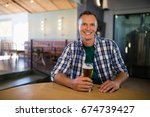 portrait of smiling man having... | Shutterstock . vector #674739427