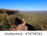 girl sitting on stone on the... | Shutterstock . vector #674749261