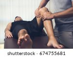 male therapist massaging knee... | Shutterstock . vector #674755681