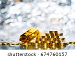 stacking gold coins with...