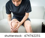asian man holds on to the knee  ... | Shutterstock . vector #674762251