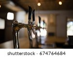 close up of beer pump at... | Shutterstock . vector #674764684