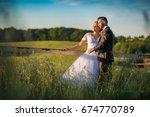 wedding couple on nature. | Shutterstock . vector #674770789