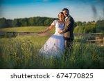 wedding couple on nature. | Shutterstock . vector #674770825