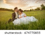 wedding couple on nature. | Shutterstock . vector #674770855