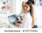 young employee working on... | Shutterstock . vector #674772331