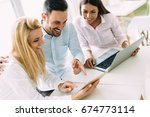 three young smiling colleagues... | Shutterstock . vector #674773114