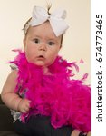 a baby girl with a shocked... | Shutterstock . vector #674773465