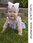 a beautiful baby girl  laying... | Shutterstock . vector #674773471