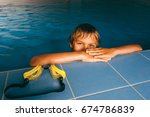 boy in swimming pool at... | Shutterstock . vector #674786839