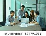 teamwork of asian business... | Shutterstock . vector #674791081