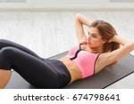 fitness woman lying doing... | Shutterstock . vector #674798641