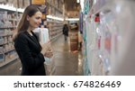 pregnant woman buys diapers at... | Shutterstock . vector #674826469
