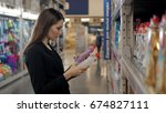 woman choosing laundry... | Shutterstock . vector #674827111