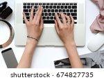 woman is working on laptop.... | Shutterstock . vector #674827735