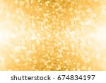 Small photo of Abstract gold glitter sparkle confetti background or golden party invite for happy birthday, 50th anniversary, champagne color banner, New Year's Eve bash, Christmas blur, engagement or bridal texture