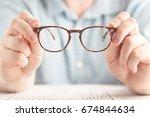 closeup image  two hands...   Shutterstock . vector #674844634