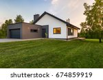 stylish house with large lawn... | Shutterstock . vector #674859919