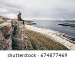 sitting on the edge of a cliff  ... | Shutterstock . vector #674877469