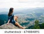 lonely young traveler girl...   Shutterstock . vector #674884891