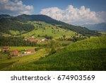 alpine farmhouse and barn on a... | Shutterstock . vector #674903569