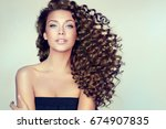 brunette  girl with long  and   ... | Shutterstock . vector #674907835