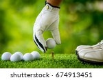 Golf Players Hand Placing Ball...