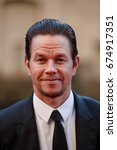 Small photo of Actor Mark Wahlberg arrives on the red carpet at the Transformers The Last Knight movie premiere on June 20, 2017 in Chicago.