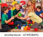 children building blocks in... | Shutterstock . vector #674928691