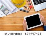 engineerman hands holding blank ... | Shutterstock . vector #674947435