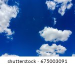 beautiful blue sky with clouds... | Shutterstock . vector #675003091