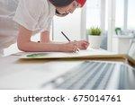 young female illustrator... | Shutterstock . vector #675014761