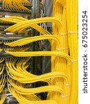 network cable on a network hub | Shutterstock . vector #675023254