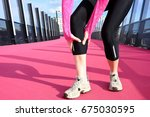 woman having muscle cramp on... | Shutterstock . vector #675030595