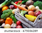 wooden box with autumn harvest... | Shutterstock . vector #675036289