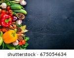 frame of organic food. fresh... | Shutterstock . vector #675054634