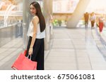 beautiful young woman hold... | Shutterstock . vector #675061081