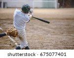 high school baseball player   Shutterstock . vector #675077401