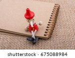 Pinocchio Sitting On Notebook...