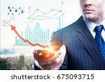 handsome businessman holding... | Shutterstock . vector #675093715
