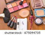makeup brushes and cosmetics... | Shutterstock . vector #675094735