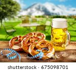 pretzels and frothy pint of... | Shutterstock . vector #675098701