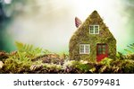 eco friendly house concept with ... | Shutterstock . vector #675099481