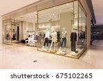 interior of fashion store in... | Shutterstock . vector #675102265