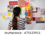 rear view of businesswoman... | Shutterstock . vector #675125911