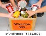 volunteer putting food in a... | Shutterstock . vector #67513879