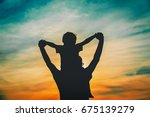 father and son play on sunset... | Shutterstock . vector #675139279